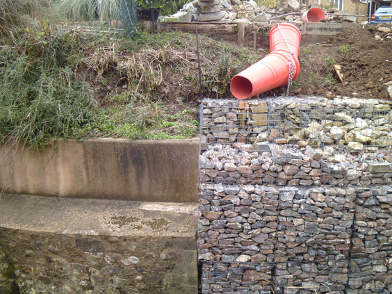 gabion wall next to a stone wall