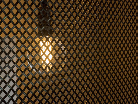 industrial mesh with oversize lightbulb behing