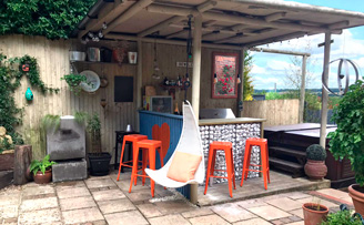 Gabion drinks bar, mesh and pebbles